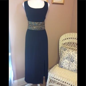 Maggy London black calf length dress.